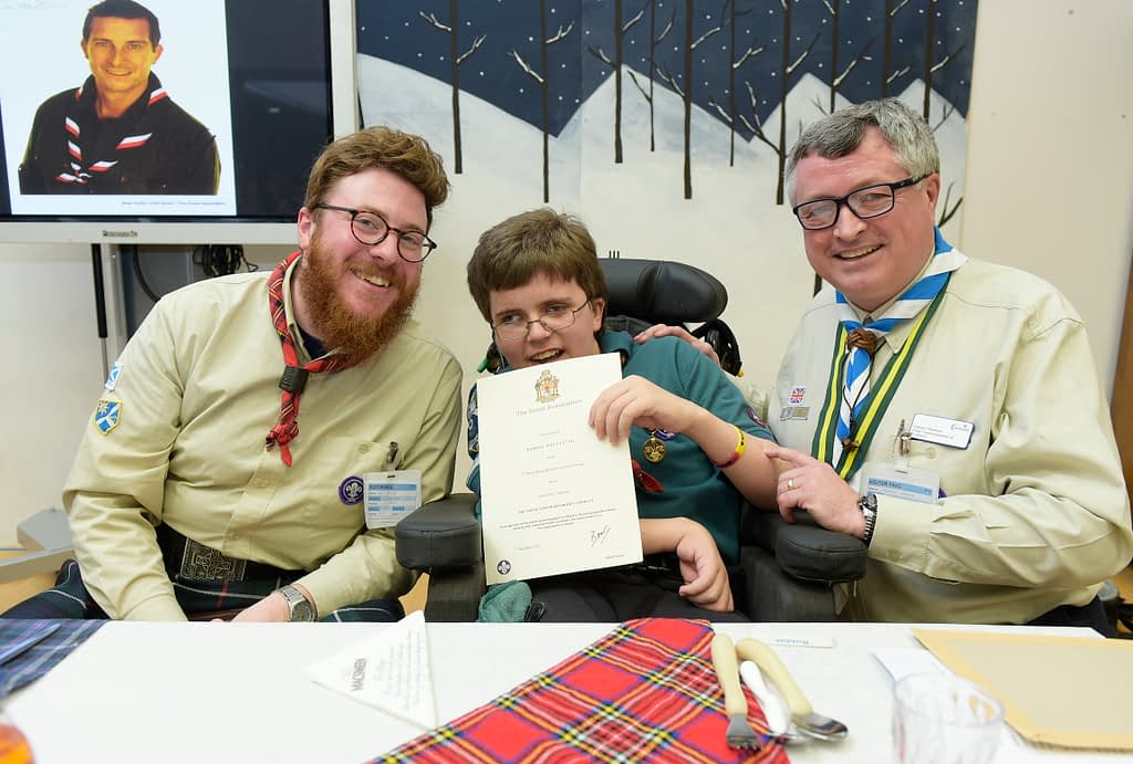 Robbie receives his award from Graham Haddock, Chief Commissioner of Scotland