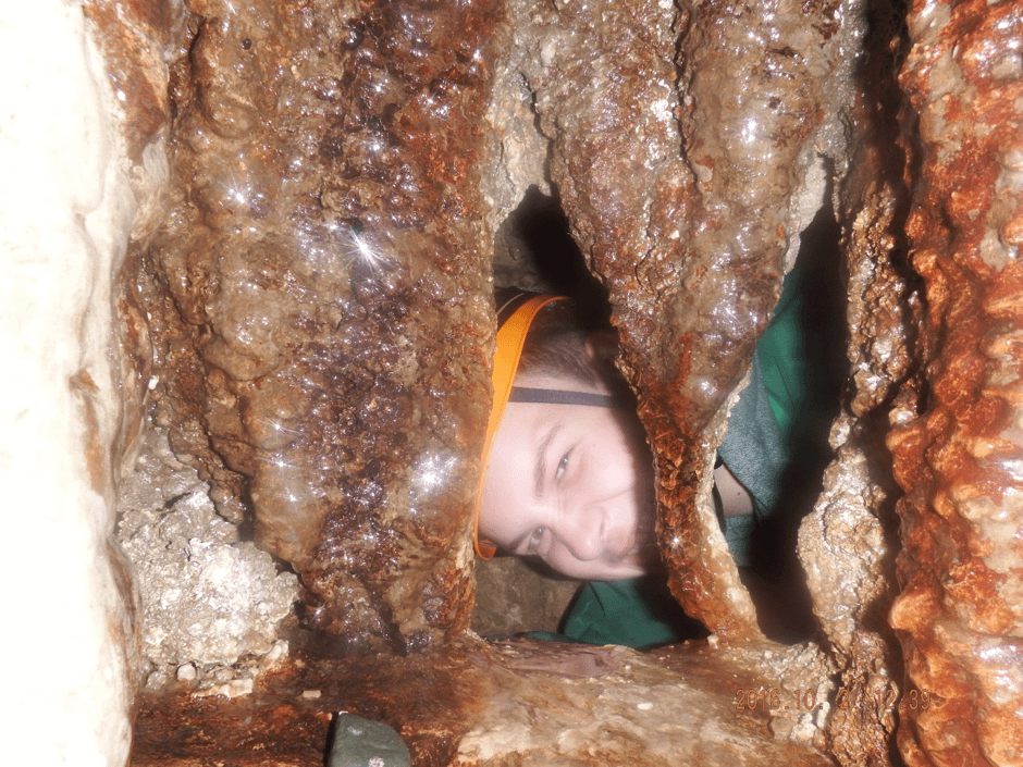 Explorer Scout being invested while caving