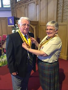 Hugh being presented with his Bar to the Silver Acorn