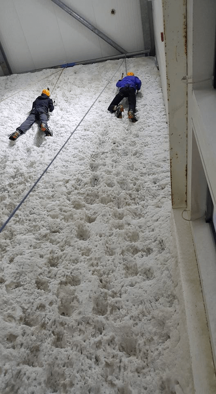 Explorers almost at the top of the ice wall