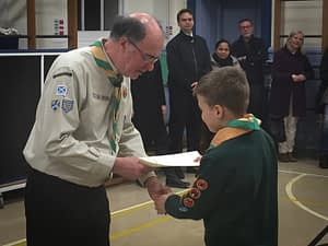 Dave presents an award to a Cub at the 11th