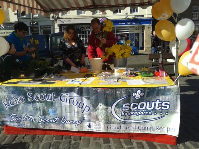The group with their daffodils and recipe book at the Kelso Farmers' Market